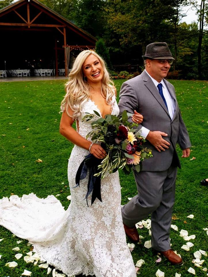 Ashley and dad walking down the aisle.jpg