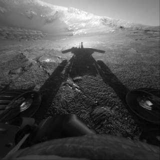 The dramatic image of NASA's Mars Exploration Rover Opportunity's shadow was taken on sol 180 (July 26, 2004) by the rover's front hazard-avoidance camera as the rover moved farther into Endurance Crater in the Meridiani Planum region of Mars.<br /><br />Credits: NASA/JPL-Caltech