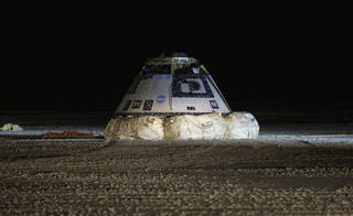 The Boeing CST-100 Starliner spacecraft is seen after it landed in White Sands, New Mexico, Sunday, Dec. 22, 2019. The landing completes an abbreviated Orbital Flight Test for the company that still meets several mission objectives for NASA's Commercial Crew program. The Starliner spacecraft launched on a United Launch Alliance Atlas V rocket at 6:36 a.m. Friday, Dec. 20 from Space Launch Complex 41 at Cape Canaveral Air Force Station in Florida.<br /><br />Credits: NASA/Bill Ingalls
