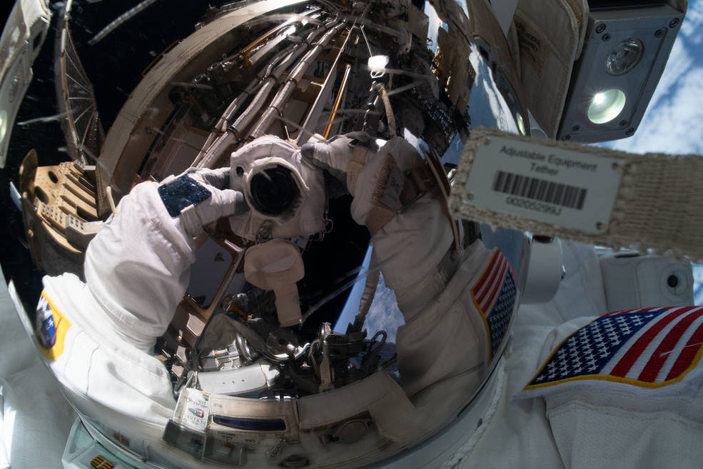 NASA astronaut Jessica Meir takes an out-of-this-world &quot;space-selfie&quot; with her spacesuit helmet visor down reflecting her camera and International Space Station hardware. She and fellow NASA astronaut Christina Koch (out of frame) ventured into the vacuum of space for seven hours and 17 minutes to swap a failed battery charge-discharge unit (BCDU) with a spare during the first all-woman spacewalk.<br />Credits: NASA