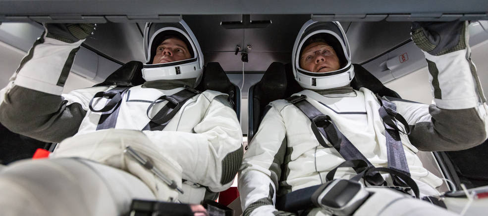 NASA astronauts Doug Hurley and Bob Behnken familiarize themselves with SpaceX's Crew Dragon, the spacecraft that will transport them to the International Space Station as part of NASA's Commercial Crew Program. Their upcoming flight test is known as Demo-2, short for Demonstration Mission 2. The Crew Dragon will launch on SpaceX's Falcon 9 rocket from Launch Complex 39A at NASA's Kennedy Space Center in Florida.<br />Credits: NASA